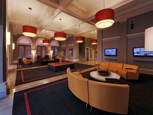 Resident lounge with seating and television