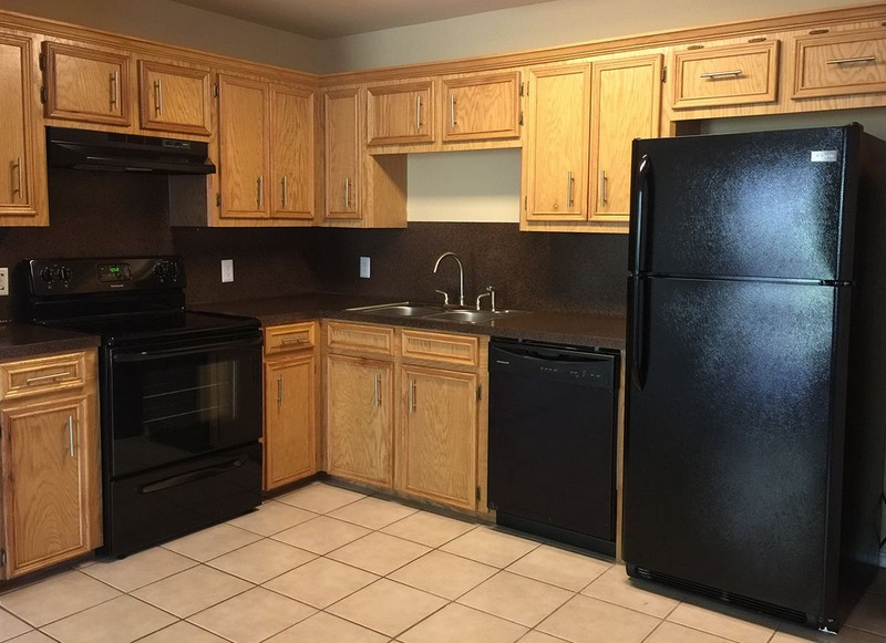 Apartment kitchen with black on black appliances