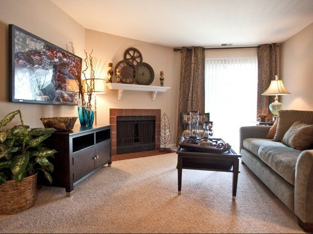Apartment living room with seating and fireplace