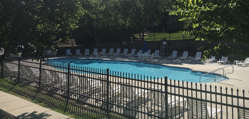 Resort style swimming pool with chairs
