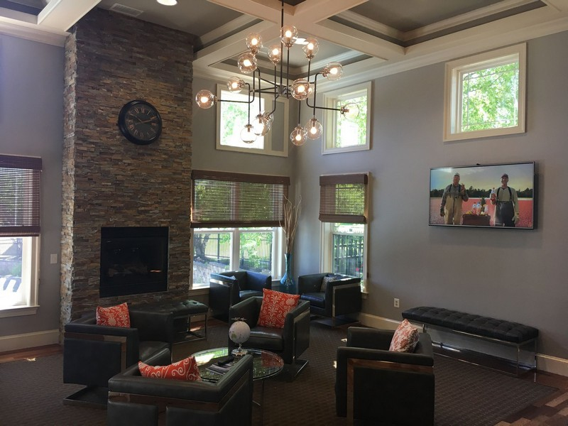 Resident clubhouse with seating and fireplace