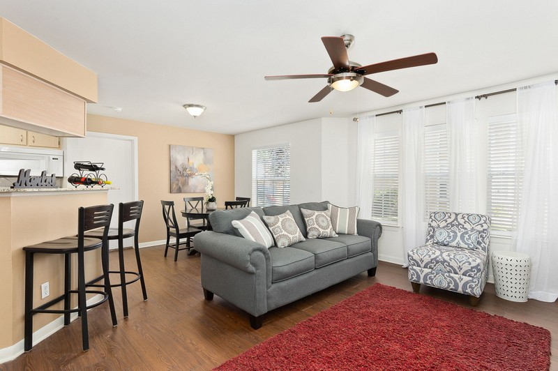 Apartment living room with wood look floor and furniture