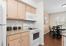 View of apartment kitchen and adjacent dining area