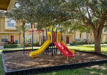 Playcenter and play area in front of apartment buildings