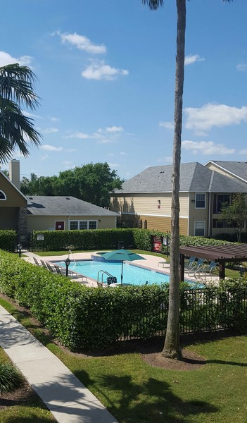 View of apartment swimming pool with lounging deck