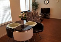 Apartment dining area overlooking living room.