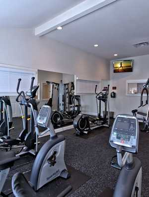 Fitness center with cardio equipment. Click to view all amenities.