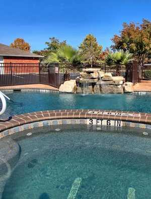Swimming pool with water feature. Click to view all amenities.