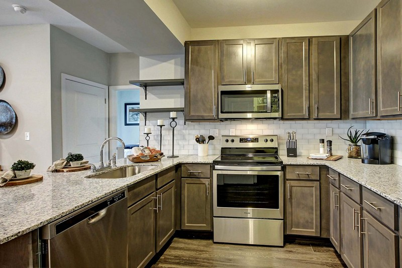 Apartment kitchen with stainless steel appliances