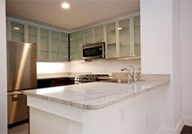 Apartments kitchen with stainless steel appliances and cabinets
