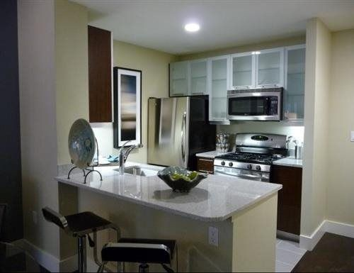 apartment kitchen with granite countertops