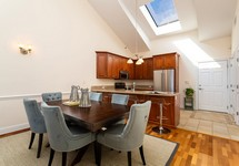 Large kitchen with vaulted ceiling and skylight