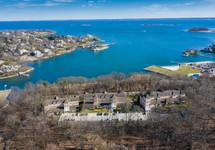 Aerial view of property with water view of long island sound