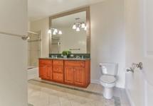 Bathroom with tan mosiaic tile and granite countertop