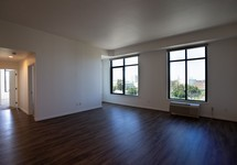Apartment living area with view of hallway