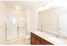 bathroom with vanity, sink, tub and toilet.  ceramic flooring