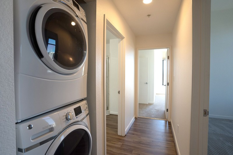 stacked washer/dryer in apartment hallway