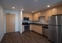 kitchen with light wood cabinets and stainless steel appliances