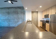 Apartment kitchen with stainless steel appliances and view of kitchen