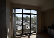 Room with large windows and view of private patio