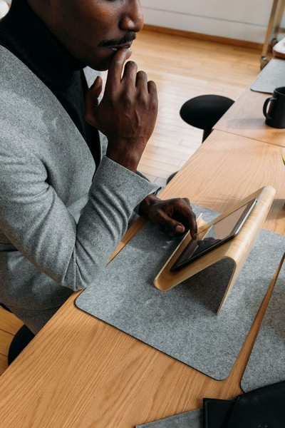 Man using tablet in home office
