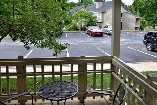 patio on ground floor of apartment, rails all around