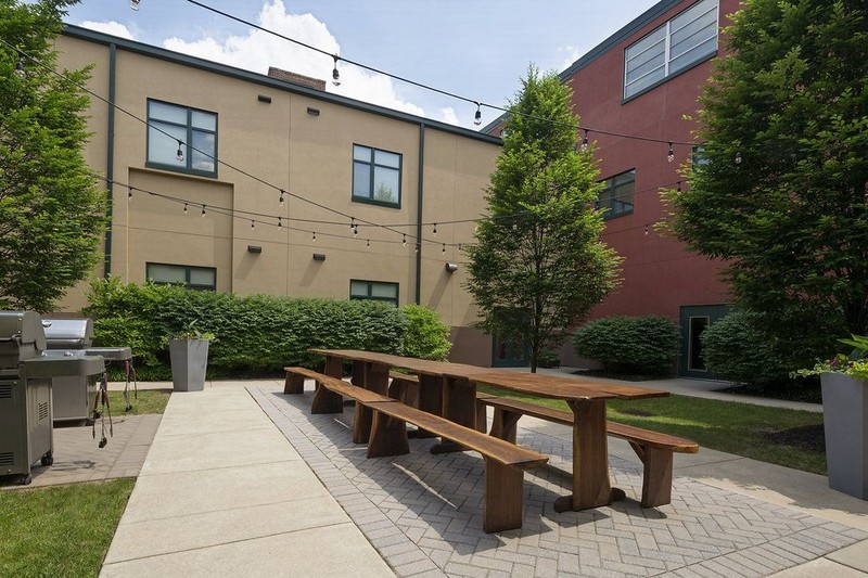 Courtyard with table and stainless steel grills