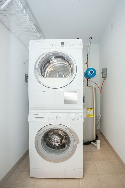 Stacked washer and dryer in apartment