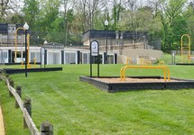 grassy area with different fitness stations