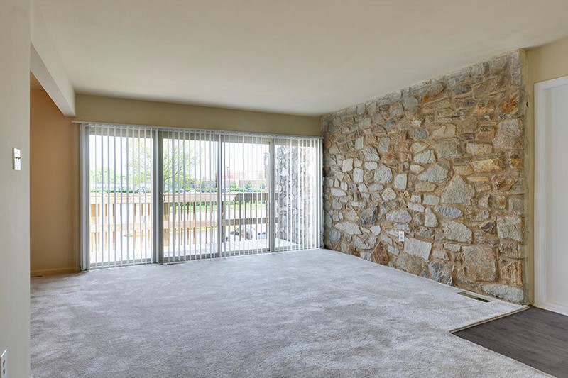 living area with wall of rocks