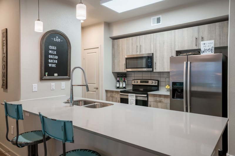 Apartment kitchen with bar area and seating
