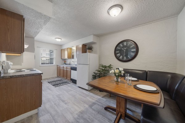 Apartment kitchen and dining area. Click to view the photo gallery.