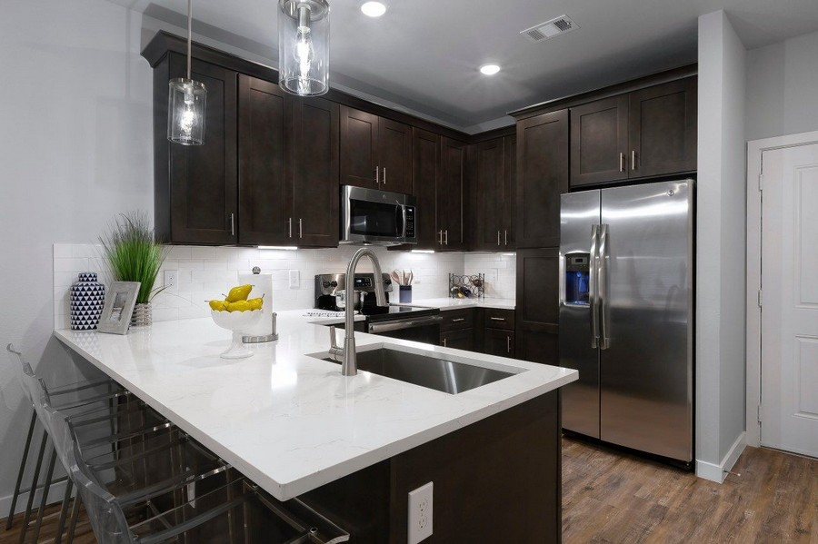 Kitchen with peninsula and stainless steel appliances