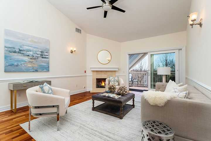 Large living area with fireplace and large sliding glass doors. Click to view the full size image.