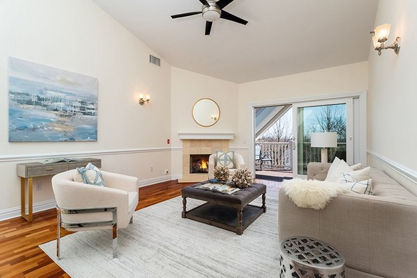 Large living area with fireplace and large sliding glass doors. Click to view the photo gallery.