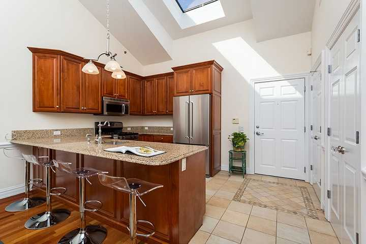 Kitchen with bar seating and granite countertops. Click to view the full size image.