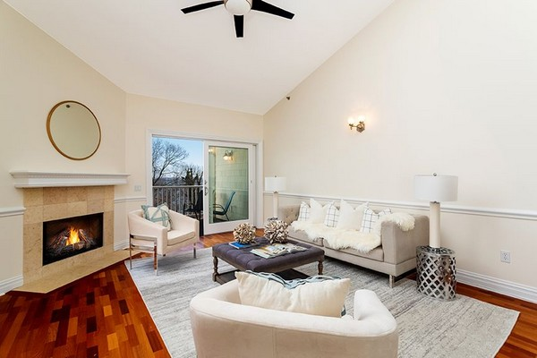 Living area with hardwood floor and sliding glass door leading to patio. Click to view the photo gallery.