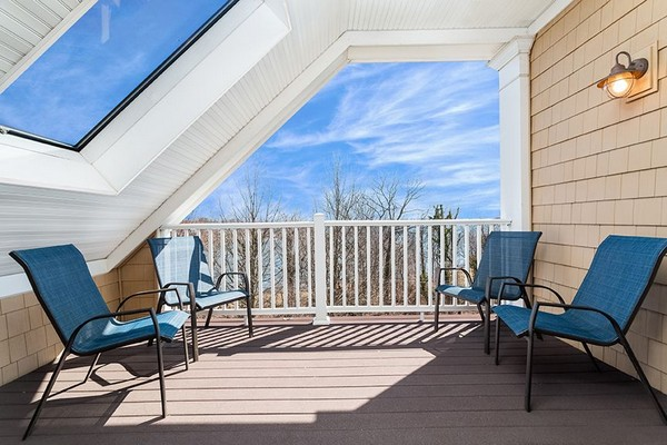 Private patio with blue lounge chairs and large skylight. Click to view the photo gallery.