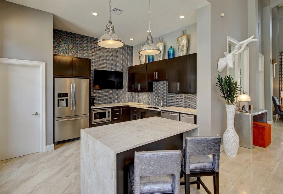 Clubhouse kitchen with bar and stainless steel appliances
