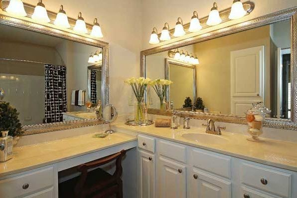 Apartment bathroom with large vanity. Click to view the photo gallery.