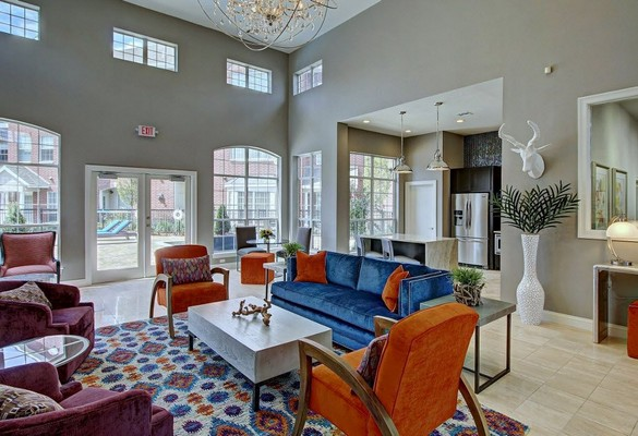 Resident lounge with seating and view of kitchen. Click to view the photo gallery.