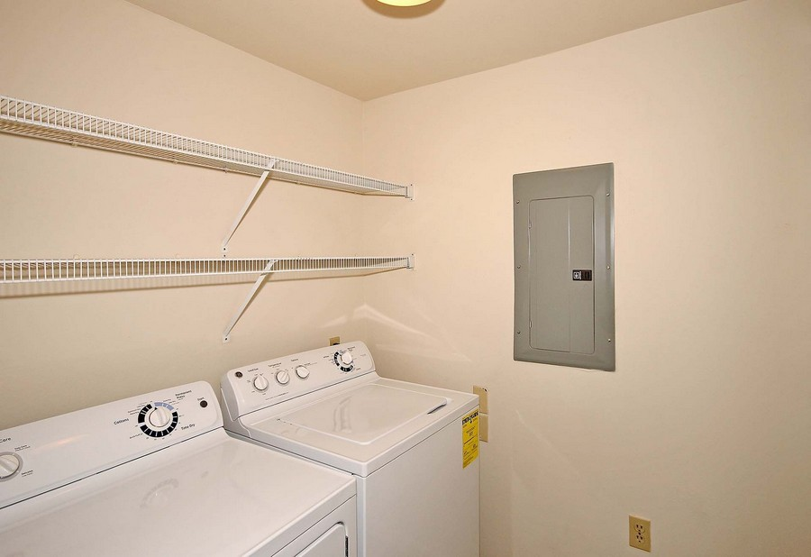 Apartment laundry room with washer and dryer