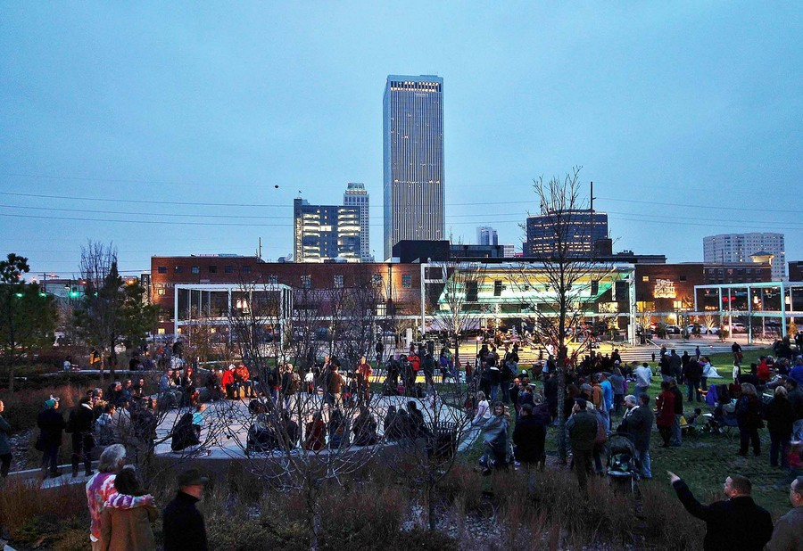 Outdoor green space with view of Tulsa skyline