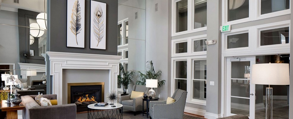 Resident lounge with seating and fireplace. Click to view the photo gallery.