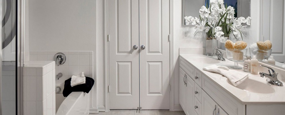 Apartment bathroom with double vanity sink. Click to view the photo gallery.