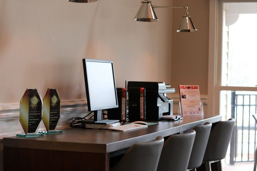 business office - desk, awards, printer