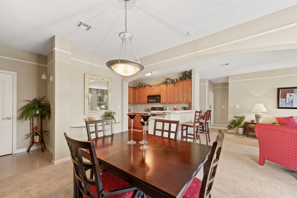 Apartment dining area with view of living room and kitchen. Click to view the photo gallery.