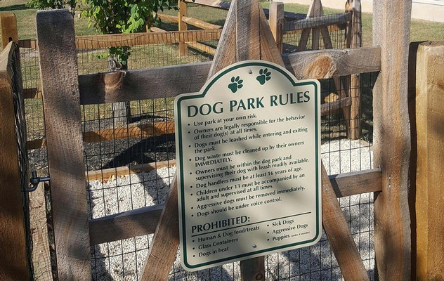Dog park rules on fenced-in dog park. Click to view the photo gallery.