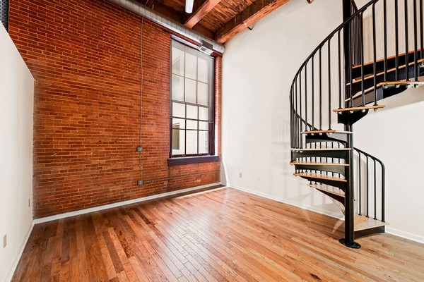Apartment living area with spiral staircase. Click to view the photo gallery.