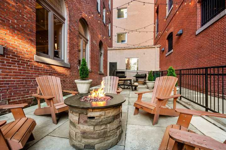 Outdoor fire pit with seating. Click to view the full size image.